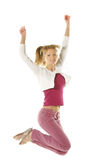 Jumping girl in pink jeans Royalty Free Stock Image