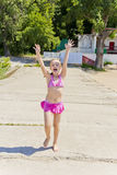 Jumping girl in pink swimsuit royalty free stock photography