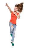 Jumping girl pointing to the side Royalty Free Stock Image