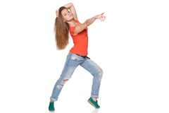 Jumping girl pointing to the side Stock Image