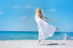 Jumping girl on sea Royalty Free Stock Images