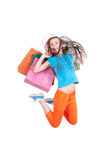 Jumping girl with shopping bags Stock Photo