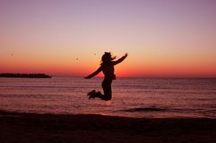 Jumping girl - silhouette. Success and freedom feel Stock Image