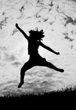 Jumping girl silhouette on white background Royalty Free Stock Images