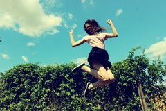 Jumping girl in the summer. Jumping girl in nature in the summer Royalty Free Stock Photos