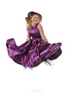 Jumping girl in violet dress Stock Photo