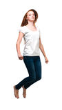 Jumping girl in a white T-shirt. Isolated on white background Stock Photo