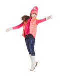 Jumping girl in winter clothes, on white Royalty Free Stock Photography