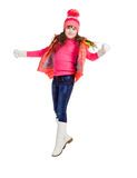 Jumping girl in winter clothes, on white Stock Photos