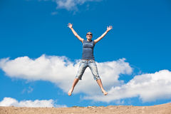 Free Jumping Girl With Hands Up Against Stock Photos - 25174803