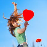 Jumping Girl With Heart Royalty Free Stock Photo