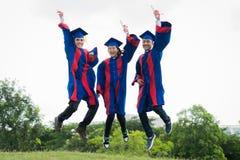 Jumping graduates Royalty Free Stock Photos
