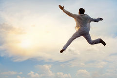 Jumping guy in sky Stock Images