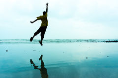 Jumping of Happiness. Near the beach Stock Image