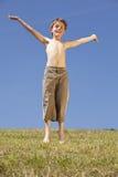 Jumping happy boy royalty free stock photos