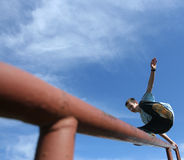 Jumping happy boy. Young boy jumping on the balustrade Royalty Free Stock Images