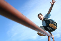 Jumping happy boy. Young boy jumping on the balustrade Stock Photography