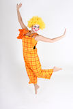 Jumping happy clown in costume Stock Image