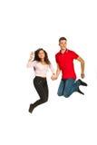 Jumping happy couple Stock Photos