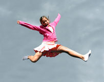 Jumping happy girl. Against the sky