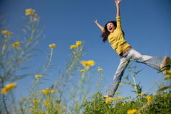 Jumping happy girl Stock Images
