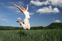 Jumping happy girl Stock Photo