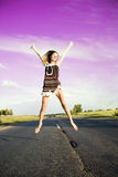 Jumping happy girl Royalty Free Stock Photos