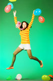 Jumping happy girl with balloons Royalty Free Stock Photography