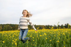 Jumping happy girl outdoor Stock Images