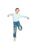 Jumping happy kid boy stock image