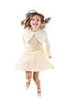 Jumping happy little girl isolated Stock Image