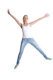 Jumping happy teen girl Stock Photography