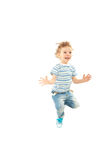 Jumping happy toddler boy Stock Image