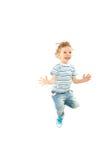 Jumping happy toddler boy stock image