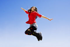 Jumping happy woman Royalty Free Stock Images