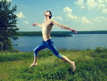 Jumping happy young man Stock Images