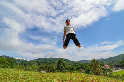 Jumping happy young man Stock Photography