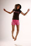 Jumping high. Teenage girl in work-out cloths jumping Royalty Free Stock Photography