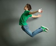 Jumping high. Artistic shot of a guy jumping high and posing meanwhile Royalty Free Stock Photography