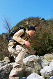 Jumping hiker Royalty Free Stock Images