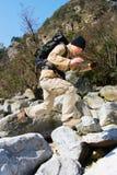 Jumping hiker Royalty Free Stock Image