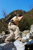 Jumping hiker Stock Image