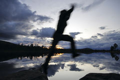 Jumping Hiker in the Blue Hour Royalty Free Stock Images