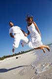 Jumping Honeymoon Couple Stock Image