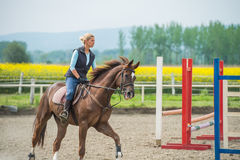 Jumping with horse Royalty Free Stock Photos