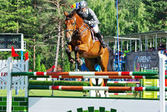 Jumping hurdle event. Horse jumping hurdle at CSIO2*-W & Balkan Tour, Piatra Neamt (Romania) 4-7 june 2009. Laszlo Gombos from Hungary on the horse ''Charisma Stock Photography