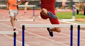 Jumping at hurdle race Royalty Free Stock Images