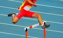 Jumping hurdles Stock Photo