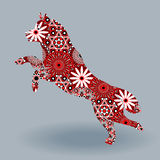 Jumping Husky Dog with stylized flowers over grey. Jumping Dog of  Husky breed, vector stencil silhouette fill with stylized flowers in red, white and black Stock Photo