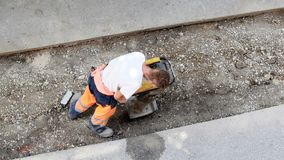 Jumping jack soil compactor stock footage